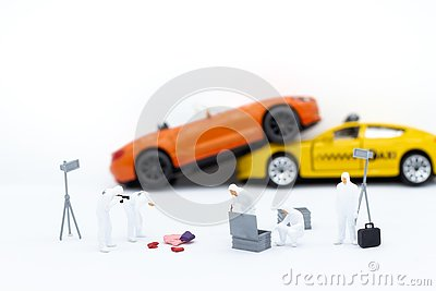 Miniature people: Inspection team looking for evidence of accident. Image use for Living with carelessness, danger on the road,