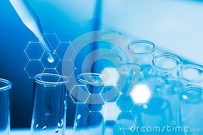 Dropping chemical liquid to test tube, laboratory research and development concept