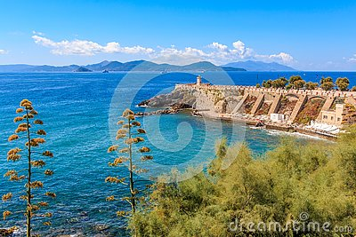 View of the terrace Giovanni Bovio and the lighthouse of Rocchetta in Piombino, Tuscany, Italy, in the background Elba Island