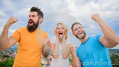 Favorite team won competition. Woman and men look successful celebrate victory sky background. Threesome stand happy