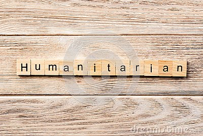 Humanitarian word written on wood block. humanitarian text on table, concept