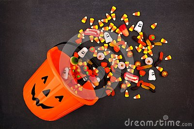 Halloween Jack o Lantern pail, top view with spilling candy
