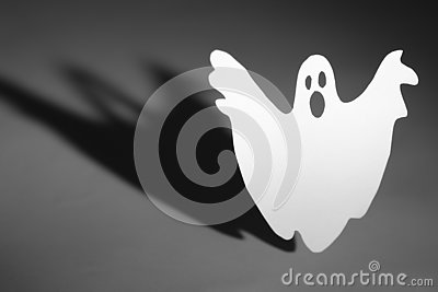 Halloween background concept. Funny ghost doing boo gesture and