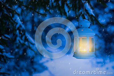 Lantern for Christmas in the woods under the tree. Lantern with