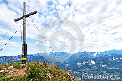 A wood cross on top of the mountain Kalmberg and rays of the sun. Beautiful landscape. Salzkammergut region