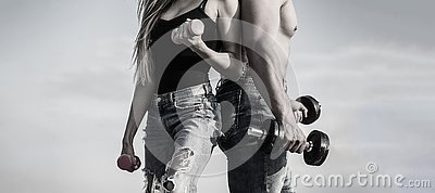 stock image of sport, dumbbell, fitness, couple sports. sportive woman and man, team. sporty couple showing muscle and workout