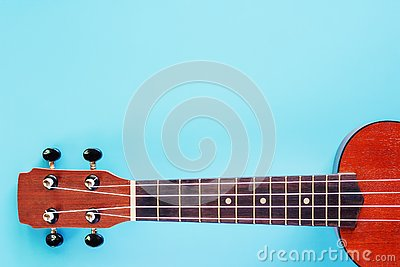 stock image of ukulele on blue background