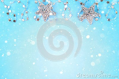 Christmas composition from Christmas tree toys. White decor on a blue background. Copy space, flat lay, top view.