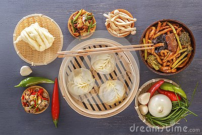 Traditional snacks of Chinese cuisine dim sum - dumplings, spicy salads, vegetables, noodles, steam bread