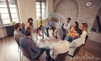 Business people talking at group meeting