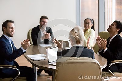 stock image of happy business people congratulating partner woman in office at