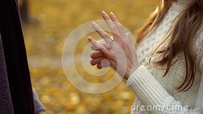 Lady trying on engagement ring gifted by boyfriend, precious gift, betrothal
