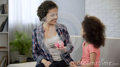 Mum telling daughter about family budget planning, financial education for kids