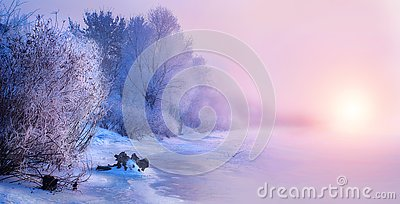 Beautiful winter landscape scene background with snow covered trees and iced river