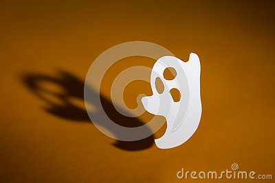 Halloween background concept. Handmade ghost and graphic shade,