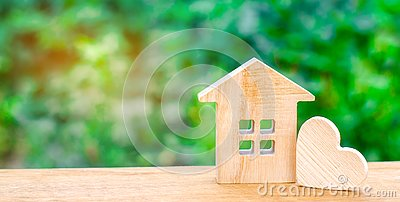 stock image of house with a wooden heart. house of lovers. affordable housing for young families. valentine`s day house.