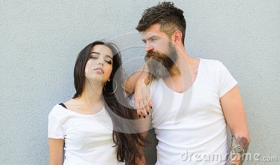 Feel their style. Couple white shirts cuddle each other. Hipster bearded and stylish girl hang out urban romantic date