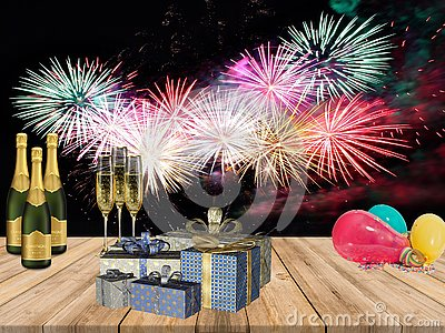 New years party table with champagne drinks gifts balloons and fire works background