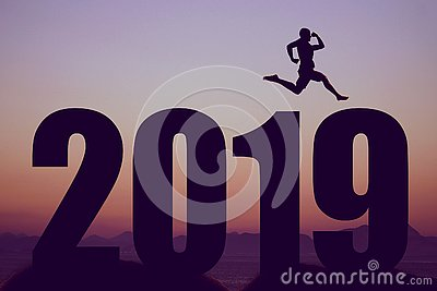 New year 2019 silhouette with jumping man as symbol for changes