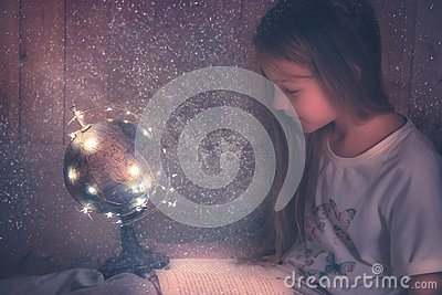 Curious admiring kid girl with book in bed dreaming about space and universe concept astronomy curiosity knowledge education deve
