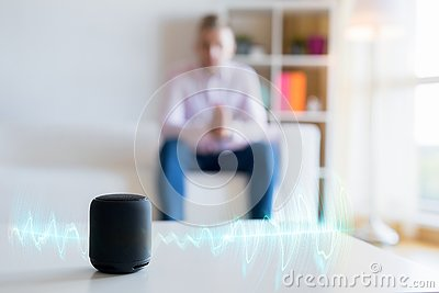 Man using virtual assistant, smart speaker at home