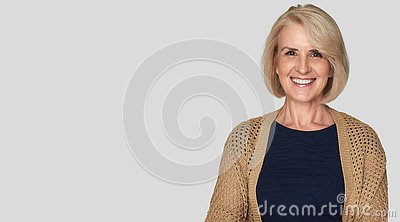 Beautiful old woman is smiling toothy