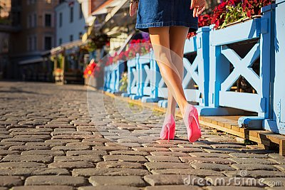 Woman wearing expressive pink shoes
