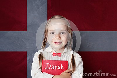 Danish concept. Child girl student with book