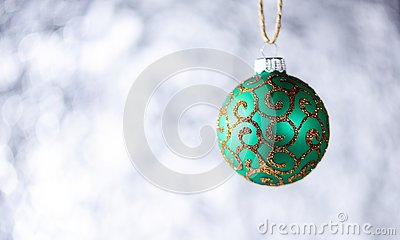 Christmas decoration or toy for Christmas tree with shimmering details, copy space. Decoration concept. Festive ornament