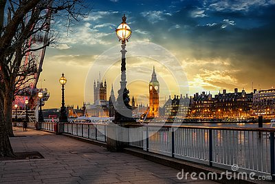 The London riverside of the Thames with view to the Big Ben during sunset