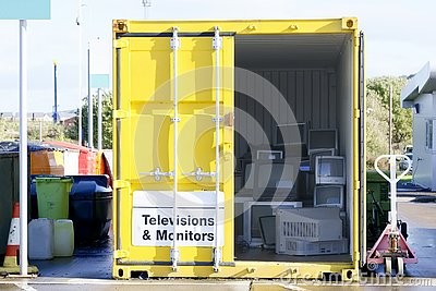 stock image of old television tv monitors pc computer screens at refuse dump skip recycle stacked pile in yellow container to help environment re