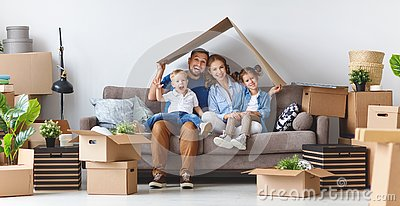 Happy family mother father and children move to new apartment an