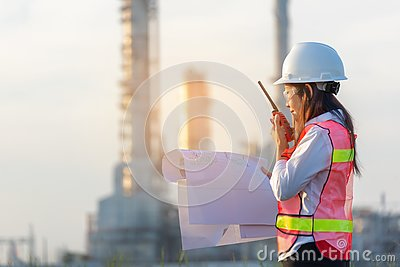 stock image of industry safety. the people worker women engineer work control at power plant energy industry manufacturing,