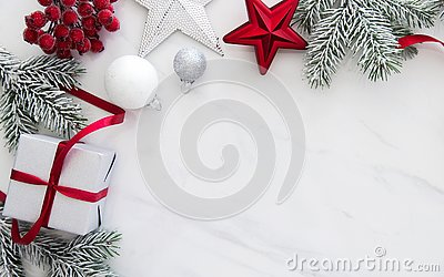 Christmas handmade gift boxes on white marble background top view. Merry Christmas greeting card, frame. Winter xmas holiday theme