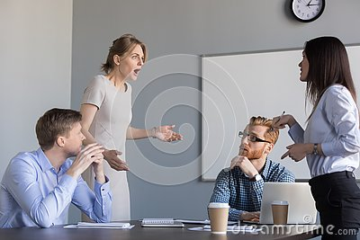 Businesswomen colleagues disputing at corporate office meeting,