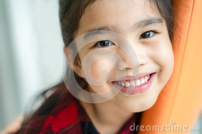 Asian little girl smiling with perfect smile and white teeth in dental care