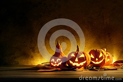 Halloween pumpkins of night spooky on wooden