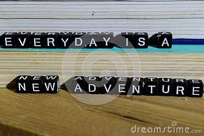 Everyday is a new adventure on wooden blocks. Motivation and inspiration concept