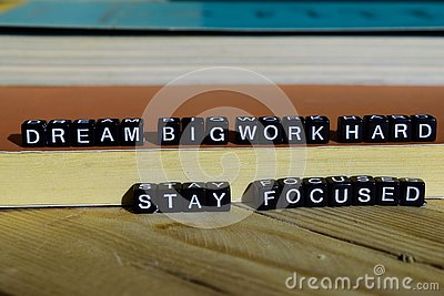 Dream big work hard stay focused on wooden blocks. Motivation and inspiration concept