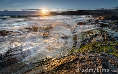 Late light catching surf over rocks, Constantine Bay, Cornwall