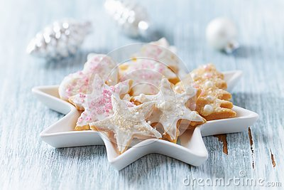 Christmas butter cookies with icing and sugar pearls.