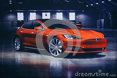 stock image of photo of the image of an electric vehicle tesla at the tesla motor show in berlin. a modern electric car.