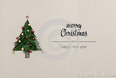 Merry Christmas and happy new year greetings in vertical top view cardboard with natural eco decorated christmas tree
