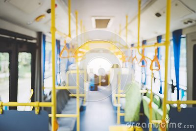 Blur image of interior in city bus, transport, tourism and road