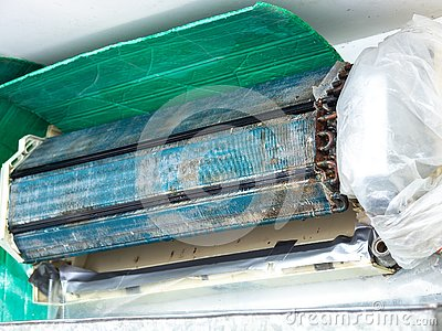Older air conditioner in the wash. After not maintaining it for a long time. Dusty interior And the parts are rusty. Accumulating