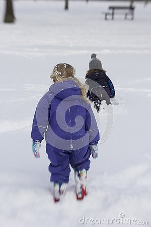 stock image of children enjoying a white christmas in scotland.
