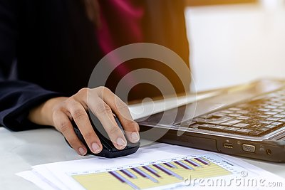 stock image of business women using the laptop computer working.