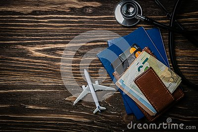 Medical tourism concept - passports, stethoscope, airplane, money