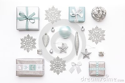 Beautiful christmas gifts and silver snowflakes and ornaments isolated on white background. Christmas composition.