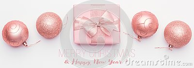 Christmas banner. Beautiful pink christmas gift and ornament baubles isolated on white background.
